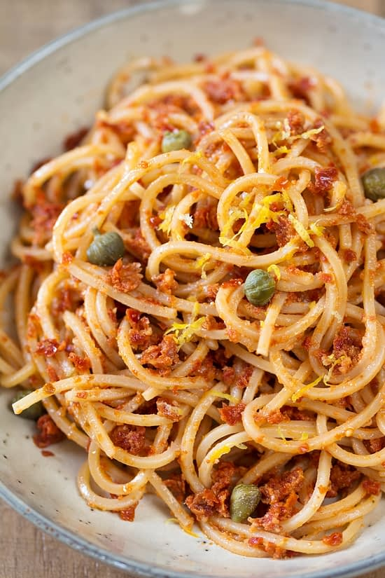 Spaghetti alla chitarra with red pesto, capers and lemon zest.