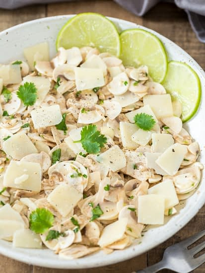 Raw mushroom salad made with cultivated mushrooms, lime, cilantro and parmigiano flakes.