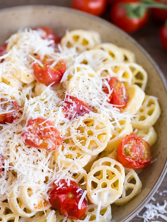 Oven-roasted cherry tomato pasta closeup.