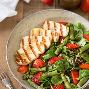 Halloumi asparagus salad with strawberries and quinoa.