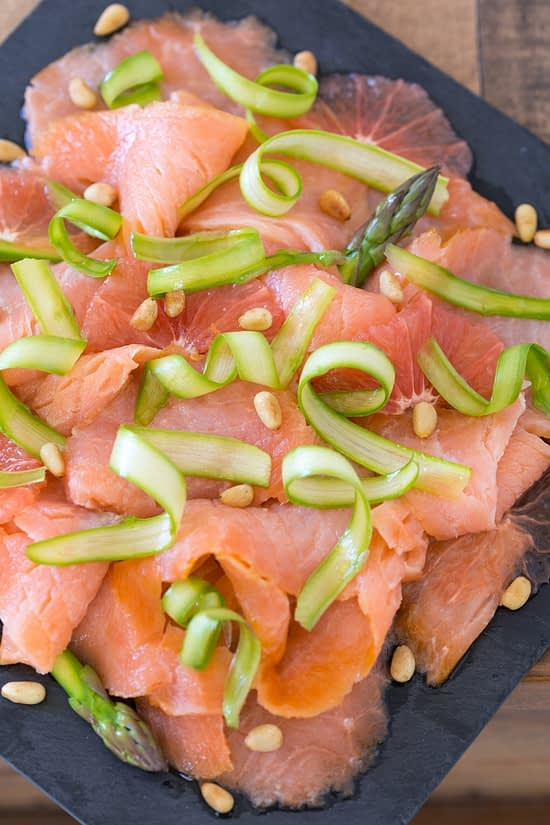 Smoked salmon carpaccio with grapefruit and shaved asparagus.
