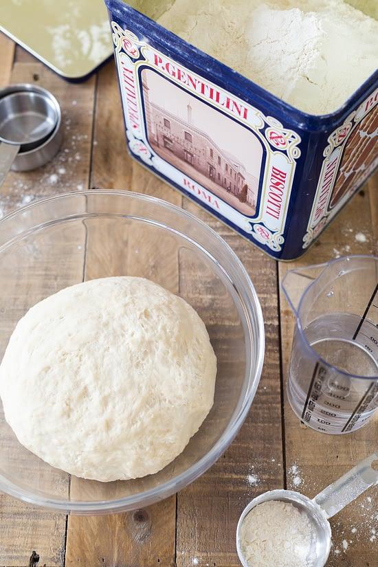 Pizza dough ball, water, flour.